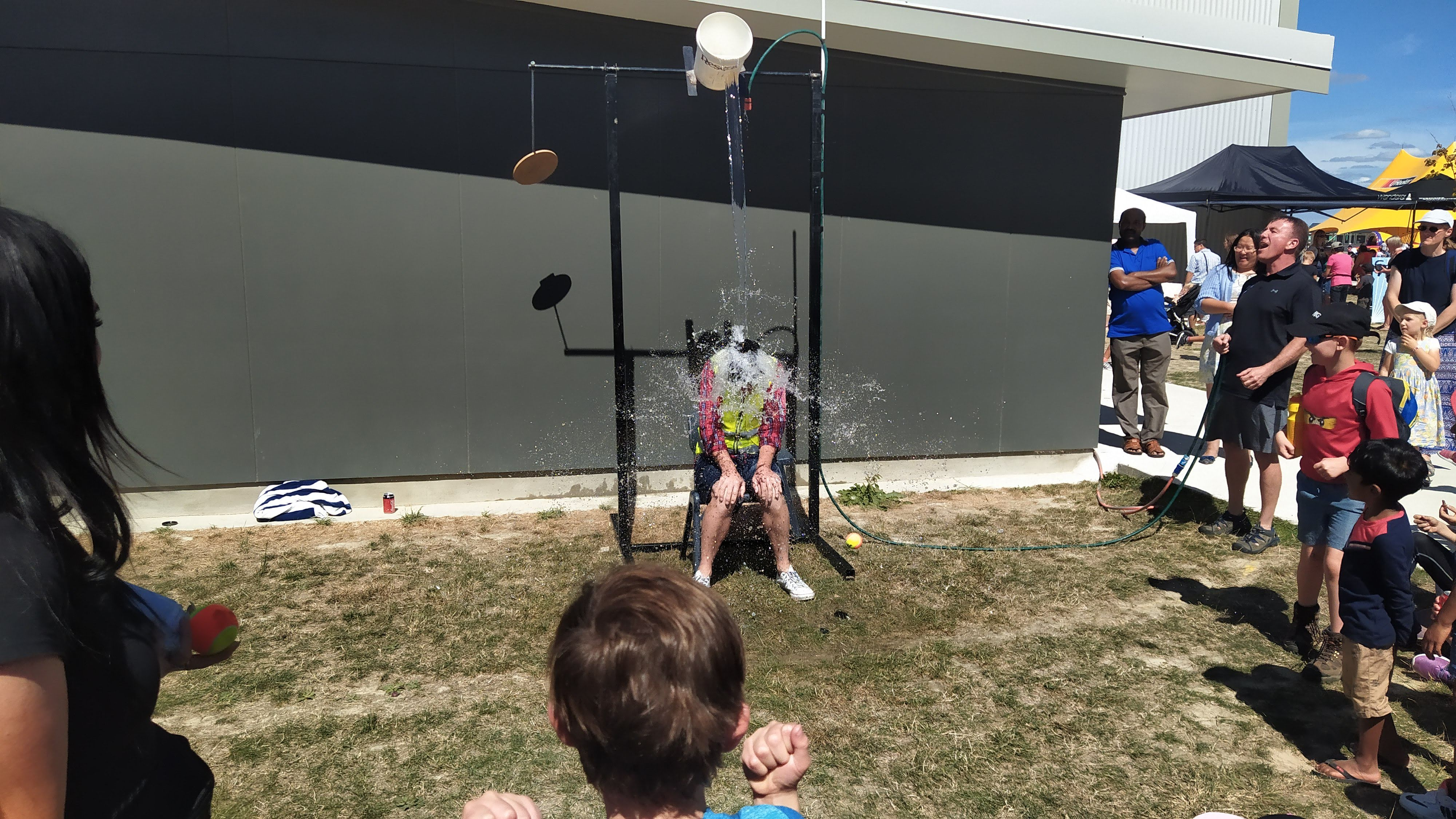 """Mr Rose gets """"Dunked"""", much to the enjoyment of Mr Mitchell (Right)"""