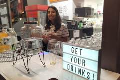 Andrea serving drinks