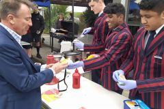 New Principal Mr Mitchell buys a hot dog
